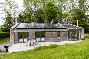 Detached house with solar panels on the roof - FMKF05811