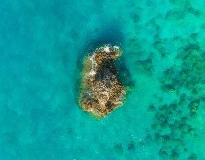 Aerial view of isolated rock formation next to Lefkada, Greece - AAEF00289