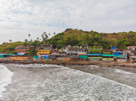Aerial view of colorful huts by the Arambol beach in north goa, India - AAEF00310