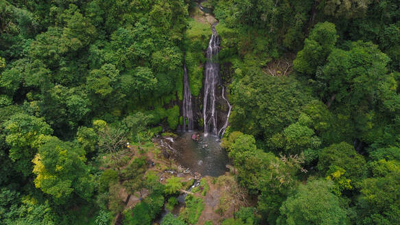 Aerial view of Banyumala Twin Waterfalls in the midle of a jungle during the daylight in North-East Bali, Indonesia - AAEF00337