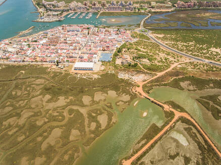 Aerial view of a city surrounded by wetland in Andalusia, Spain - AAEF00856