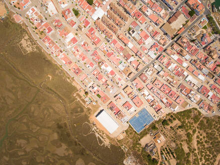 Aerial view of city surrounded by wetland in Andalusia, Spain - AAEF00859