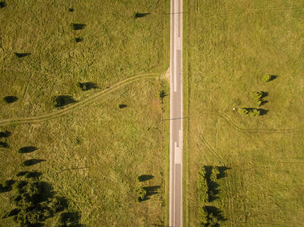 Aerial view of a en empty straight road in countryside of Estonia. - AAEF01006