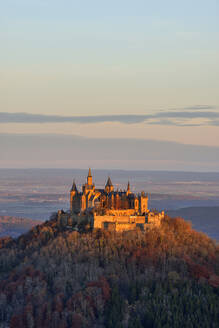 Scenic view of Hohenzollern Castle on mountain against sky during sunset, Germany - RUEF02312