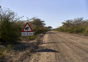 Beware of elephants sign by dirt road at Bwabwata National Park, Namibia - VEGF00473