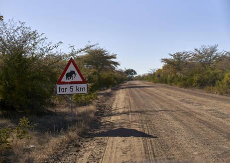 Beware of elephants sign by dirt road at Bwabwata National Park, Namibia - VEGF00473