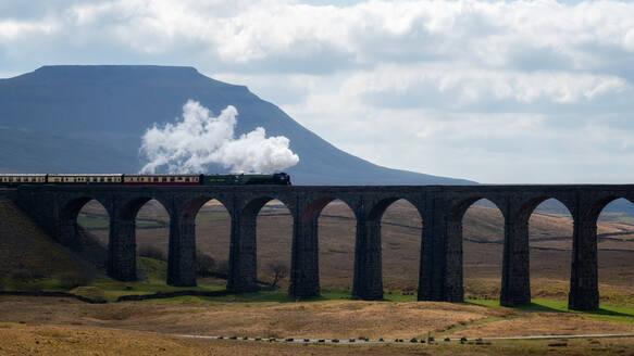 Steam train crossing the Ribblehead Viaduct, Yorkshire Dales National Park, Yorkshire, England, United Kingdom, Europe - RHPLF00121