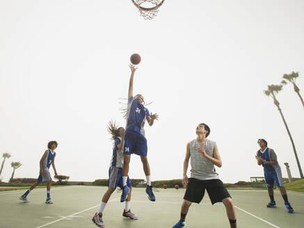 Basketball teams playing on court - BLEF13789