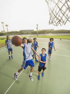 Basketball teams playing on court - BLEF13798