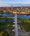 Aerial view of Stone Bridge over Danube River in Regensburg, Bavaria, Germany - SIEF08854