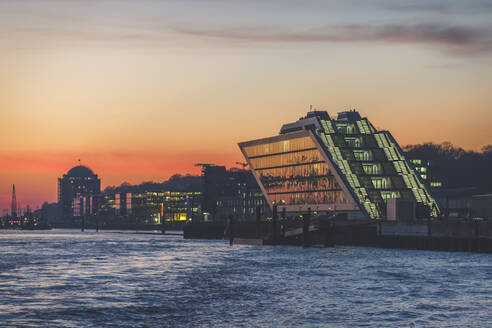 View of Dockland building by Elbe River against sky during sunset, Hamburg, Germany - KEBF01275