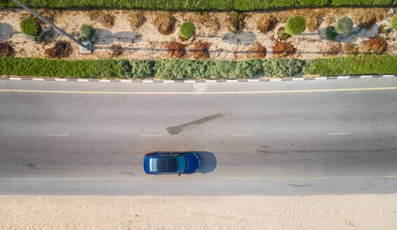 Aerial view of a car driving in Dubai, UAE - AAEF01068