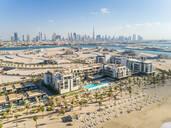 Aerial view of resort and beach on Pearl Jumeirah island in Dubai, UAE - AAEF01077