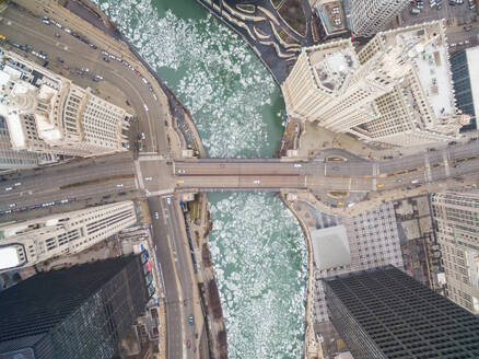 Aerial view of frozen Chicago River crossing business center, USA - AAEF01278