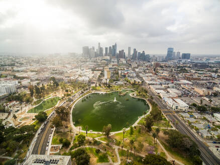 Aerial view above of MacArthur Park with downtown Los Angeles at the background, USA. - AAEF01314