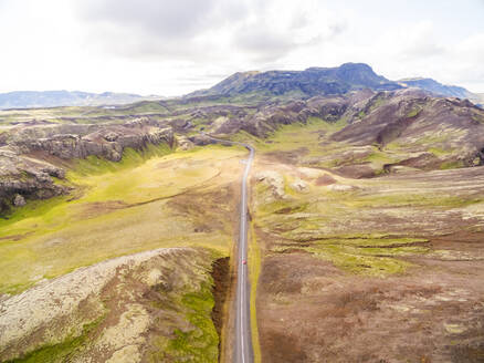 Aerial view of road crossing mountain region, Iceland - AAEF01341