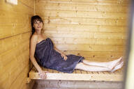 Portrait of woman relaxing in a sauna - FMKF05868