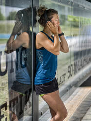 Young sportive woman wearing headphones - STSF02186