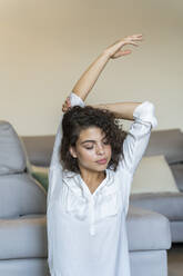Young woman stretching at home - AFVF03768