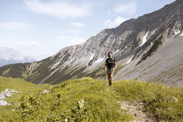 Woman hiking in the mountains - FKF03545
