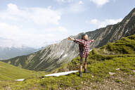 Girl hiking in the mountains enjoying nature - FKF03551