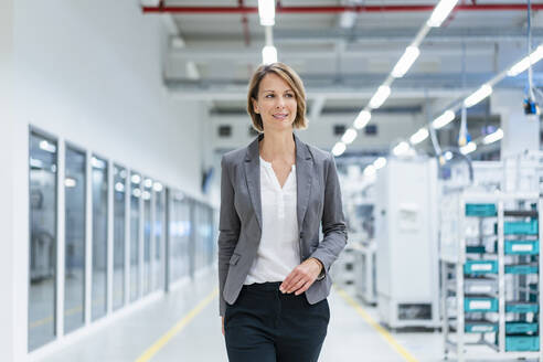 Portrait of a confident businesswoman in a modern factory - DIGF07850
