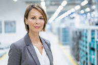 Portrait of a confident businesswoman in a modern factory - DIGF07871