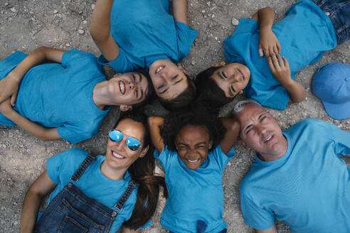Group of people happy lying on the ground - JCMF00124
