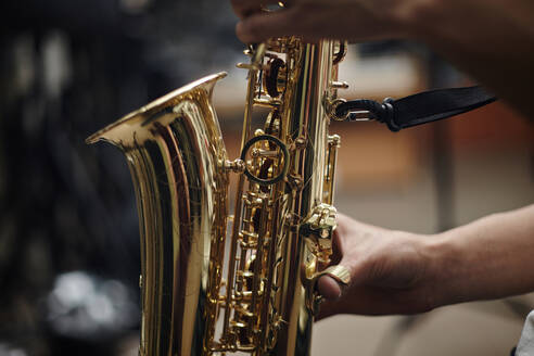 Close up of Caucasian man playing saxophone - BLEF13908