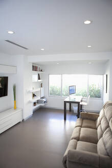 Sofa, coffee table and windows in modern living room - BLEF13968
