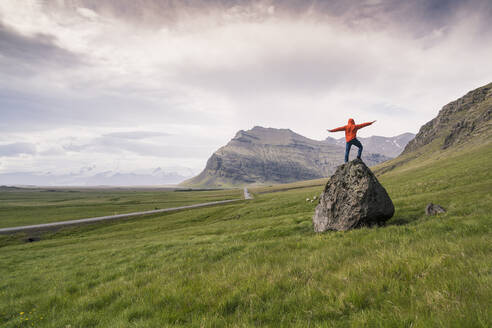 Man standing on rock in gthe Southern Region, Iceland - UUF18724