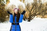 Caucasian girl throwing snow field - BLEF14369