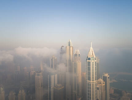 Aerial view of skyscrapers touching the clouds in Dubai, United Arab Emirates. - AAEF01757