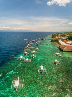 Aerial view of resort, coral reef and filipino boats, Moalboal, Philippines - AAEF01814