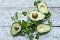 Directly above shot of avocados with parsley on wooden table - ASF06489
