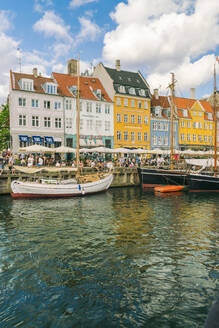 Nyhavn with old colourful buildings and boats anchored in summer, Copenhagen, Denmark, Europe - RHPLF00338