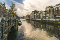 Canal at the historic centre of Amsterdam close to the red light district in autumn, Amsterdam, North Holland, The Netherlands, Europe - RHPLF00350