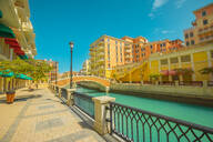 Beautiful Little Venice with canals connected by bridges in Venetian style and colourful houses in picturesque Qanat Quartier, Venice at the Pearl in sunset light, Doha, Qatar, Middle East - RHPLF00359