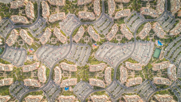 Aerial view of abstract, geometrical Discovery Gardens urban area, Dubai, UAE. - AAEF02328