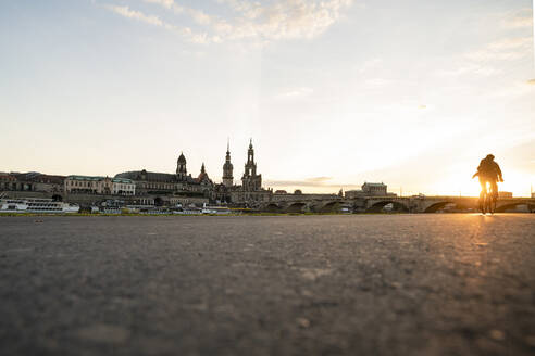 Augustus Bridge by Hofkirche and Semperoper against sky in city during sunset, Saxony, Germany - CHPF00558