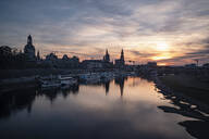 Boats moored on Elbe river against sky in city during sunset, Saxony, Germany - CHPF00561