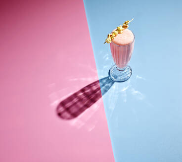 High angle view of milkshake on colored background - KSWF02046