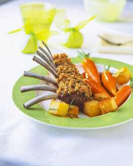 Lamb chop with carrots in plate on table - PPXF00247