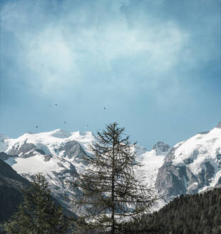 Scenic view of snowcapped mountains against cloudy sky - DWIF01023