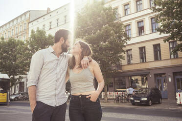 Happy young couple in the city, Berlin, Germany - TAMF02096