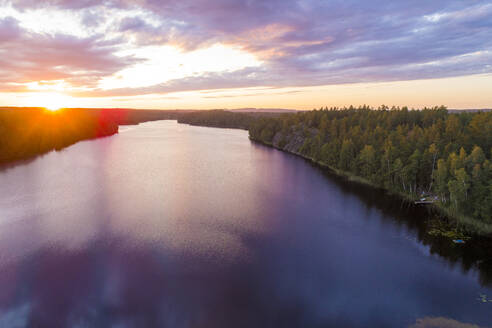 A lake at sunset in Tjust region, Southeastern Sweden - TAMF02153