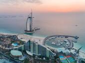 Aerial view of the luxurious Burj Al Arab Hotel and harbour at sunset on Dubai coast, UAE - AAEF02713