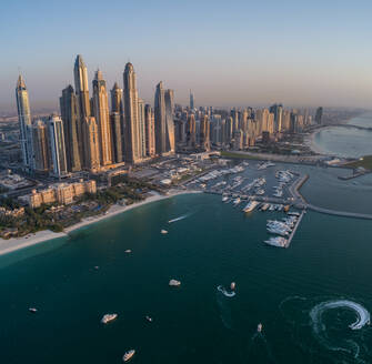 Aerial view of skyscrapers and harbour of Dubai international marine club, U.A.E. - AAEF02749
