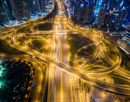 Aerial view of the traffic at night in Dubai, U.A.E. - AAEF02803