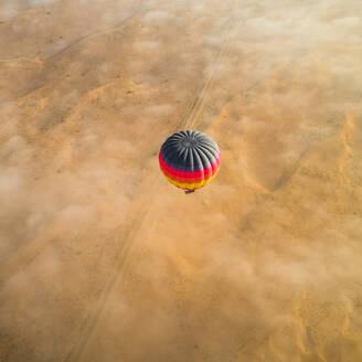 Aerial view of hot-air-balloon flying in the clouds of the Murqquab desert in Dubai, UAE - AAEF02887